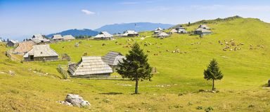 Velika Planina, which in Slovenian means great plateau is one of the most important Slovenian highlands with a particular archite. Cture of wooden huts and barns stock photos
