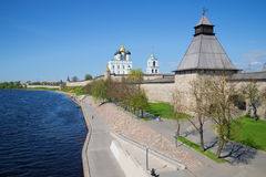 Velikaya river embankment at walls of the Pskov Kremlin in the May afternoon. Pskov, Russia Stock Photos