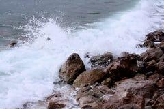 Waves crushing dark rocks. Veliki Zal beach at Dubravice near Dubrovnik, Croatia Royalty Free Stock Image