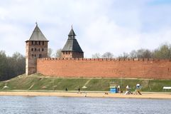 Velikiy Novgorod Kremlin and beach along the Volkhov river. Spasskaya and Dvortzovaya Towers and walls of medieval fortress in Velikiy Novgorod, Russia situated royalty free stock photos