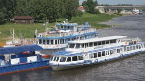Ship with tourists floating on river in Russia. VELIKIY NOVGOROD, RUSSIA - JUNE 22, 2017: Panoramic view of ship with tourists floating on the Volkhov river to stock video footage