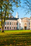 Veliky Novgorod Kremlin park with Clock Tower of St Sophia Cathedral and fallen autumn leaves in Veliky Novgorod, Russia Royalty Free Stock Photos