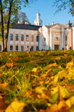 Veliky Novgorod Kremlin park with Clock Tower of St Sophia Cathedral and fallen autumn leaves in Veliky Novgorod, Russia stock photography