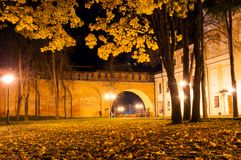 Veliky Novgorod Kremlin, Russia. City autumn park covered with autumn fallen leaves stock image