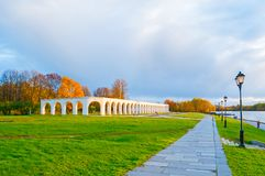 Veliky Novgorod, Russia. Arcade of the ancient Yaroslav courtyard in sunny autumn day. Veliky Novgorod, Russia. Arcade of the ancient Yaroslav courtyard in sunny Royalty Free Stock Photo