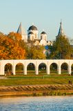 Arcade of Yaroslav Courtyard and ancient St Nicholas cathedral, Veliky Novgorod, Russia. Veliky Novgorod, Russia - arcade of Yaroslav Courtyard and ancient St Stock Photography