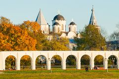 Arcade of Yaroslav Courtyard and medieval St Nicholas cathedral, Veliky Novgorod, Russia. Veliky Novgorod, Russia - arcade of Yaroslav Courtyard and ancient St Royalty Free Stock Photography