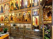 Fragment of the orthodox iconostasis inside the Khutyn Monastery. Veliky Novgorod, Russia - August 18, 2017: Fragment of the orthodox iconostasis inside the Royalty Free Stock Photos