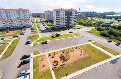 New appartment buildings and children`s playground at the reside. Veliky Novgorod, Russia - August 17, 2017: New appartment buildings and children`s playground Royalty Free Stock Images