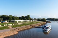 Veliky Novgorod, Russia - August 31, 2018: Panoramic view of the Yaroslav`s Court in summer. Arcade Gostiny Dvor, Embankment and. Ships with tourists. Veliky stock photography