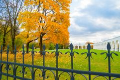 Veliky Novgorod, Russia - autumn landscape. Yaroslav Courtyard arcade and metal fence in autumn day. Veliky Novgorod, Russia - autumn landscape scene. Yaroslav Stock Photography