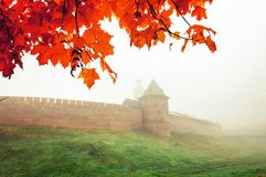 Veliky Novgorod, Russia, autumn view. Novgorod Kremlin tower framed by autumn leaves in foggy weather. In Veliky Novgorod, Russia Royalty Free Stock Image