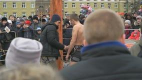 VELIKY NOVGOROD, RUSSIA, - MARCH 13: Man near pole stock video footage