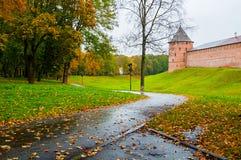 Veliky Novgorod, Russia - Novgorod Kremlin fortress tower in rainy autumn weather. Architecture view of autumn park and Veliky Novgorod Kremlin, Russia Royalty Free Stock Images