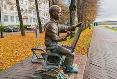 Sculpture of the painter boy at the embankment of the Volkhov river in Veliky Novgorod, Russia, autumn city view. VELIKY NOVGOROD, RUSSIA -OCTOBER 17, 2017 Royalty Free Stock Photos