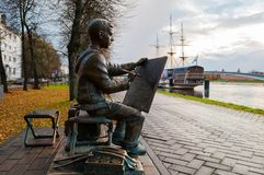 Sculpture of the painter boy at the embankment of the Volkhov river in Veliky Novgorod, Russia, autumn view. VELIKY NOVGOROD, RUSSIA -OCTOBER 17, 2017. Sculpture Royalty Free Stock Image