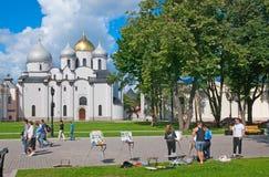 Veliky Novgorod. Russia. People in Kremlin. VELIKY NOVGOROD, RUSSIA - JULY 17, 2012. Young people draw in the center of Kremlin near The St. Sophia Cathedral ( Royalty Free Stock Image