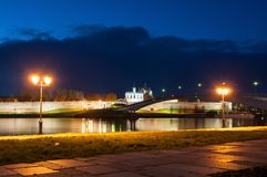 Veliky Novgorod, Russia. St Sophia cathedral, Kremlin walls, pedestrian bridge across the Volkhov river. Night city landscape of Veliky Novgorod, Russia Royalty Free Stock Photography