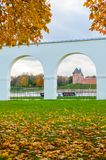 Veliky Novgorod, Russia. Yaroslav Courtyard arcade and Novgorod kremlin. In cloudy autumn day Royalty Free Stock Photo
