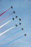 Velivoli di jet aerobatic dell'aeronautica rossa della freccia RAF Fotografie Stock