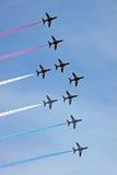 Velivoli di jet rossi dell'aeronautica delle frecce RAF Immagine Stock