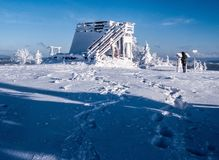 Velka Raca hill summit in Beskids mountains on slovakian - polish borders during nice winter day. Velka Raca Wielka Racza hill summit with view tower and snow in Royalty Free Stock Photo