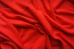 Vello rosso del tessuto, onda, drappi Bello contesto del tessuto Primo piano Vista superiore Immagini Stock Libere da Diritti