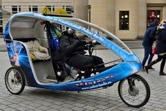 Velo rickshaw on the street in Berlin. BERLIN, GERMANY-DECEMBER 23, 2014: Velo rickshaw on the street in Berlin Stock Photos