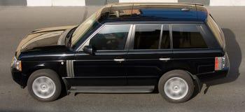 Velocidad aislada lujo del coche de SUV Fotografía de archivo libre de regalías