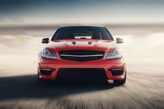 Velocidad rápida de la impulsión del coche deportivo rojo en Asphalt Road Fotografía de archivo