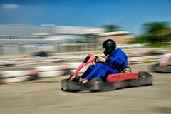 Velocidade do piloto de Kart foto de stock