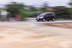 Velocidade preta da filtração do carro na estrada, Tailândia Ásia Fotos de Stock Royalty Free