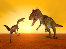 Velociraptor and Cryolophosaurus Royalty Free Stock Photos
