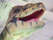 A Velociraptor Dinosaur Prowls a Research Facility Stock Photo