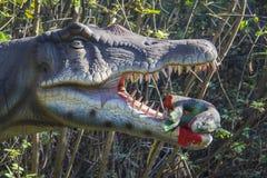 Velociraptor with prey Stock Image