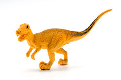 Velociraptor toy model on white background. Closeup Royalty Free Stock Photography