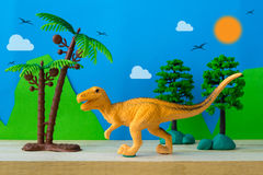 Velociraptor toy model on wild models background. Closeup Royalty Free Stock Photos