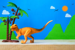 Velociraptor toy model on wild models background. Closeup Stock Photo