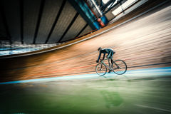 At velodrome. Athlete with a bicycle at velodrome Royalty Free Stock Image