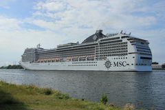 Velsen, the Netherlands, July 7th, 2014 : MSC Magnifica. On North Sea Canal from Amsterdam towards the Ijmuiden locks, The Magnifica is operated by MSC since Royalty Free Stock Photography
