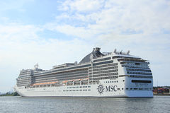 Velsen, the Netherlands, July 7th, 2014 : MSC Magnifica. On North Sea Canal from Amsterdam towards the Ijmuiden locks, The Magnifica is operated by MSC since Royalty Free Stock Image
