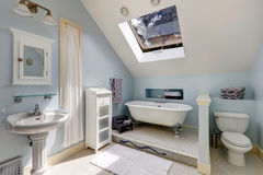 Velux bathroom with antique bath tub Royalty Free Stock Images
