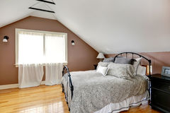 Velux bedroom with antique bed Royalty Free Stock Photos