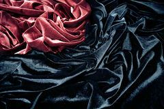 Velvet. Dark red and black glossy velvet is formative folds and light-shadow picture Royalty Free Stock Images