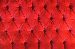 Velvet background. Detail of a red velvet couch ideal as background Royalty Free Stock Photo