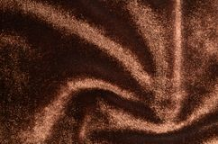 Velvet background: brown velvet fabric with a comet Royalty Free Stock Photos