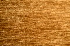 Velvet background: yellow-brown or dark-honey, linearly textured, under the even illumination Royalty Free Stock Photo
