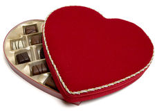 Velvet candybox. Red heart shaped velvet candy box with candies (half open) with clipping path. Valentine's day gift Stock Photo