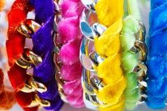 Velvet and chain bracelets Stock Images