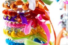 Velvet and chain bracelets Stock Photos